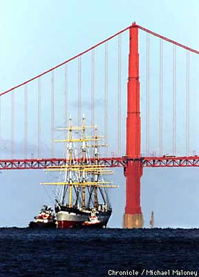 The classic 1886 sailing vessel Balclutha returns with the help of tug boats to it's berth at the Hyde Street Pier. It had been in Alameda for minor refurbishing over the winter.  CHRONICLE PHOTO BY MICHAEL MALONEY Photo: MICHAEL MALONEY