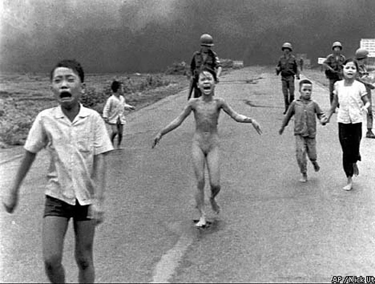 Terrified South Vietnamese children, including Kim Phuc (center), fled from the scene of an aerial attack of napalm, which became a symbol for the horrors of war. Associated Press file photo, 1972, by Nick Ut