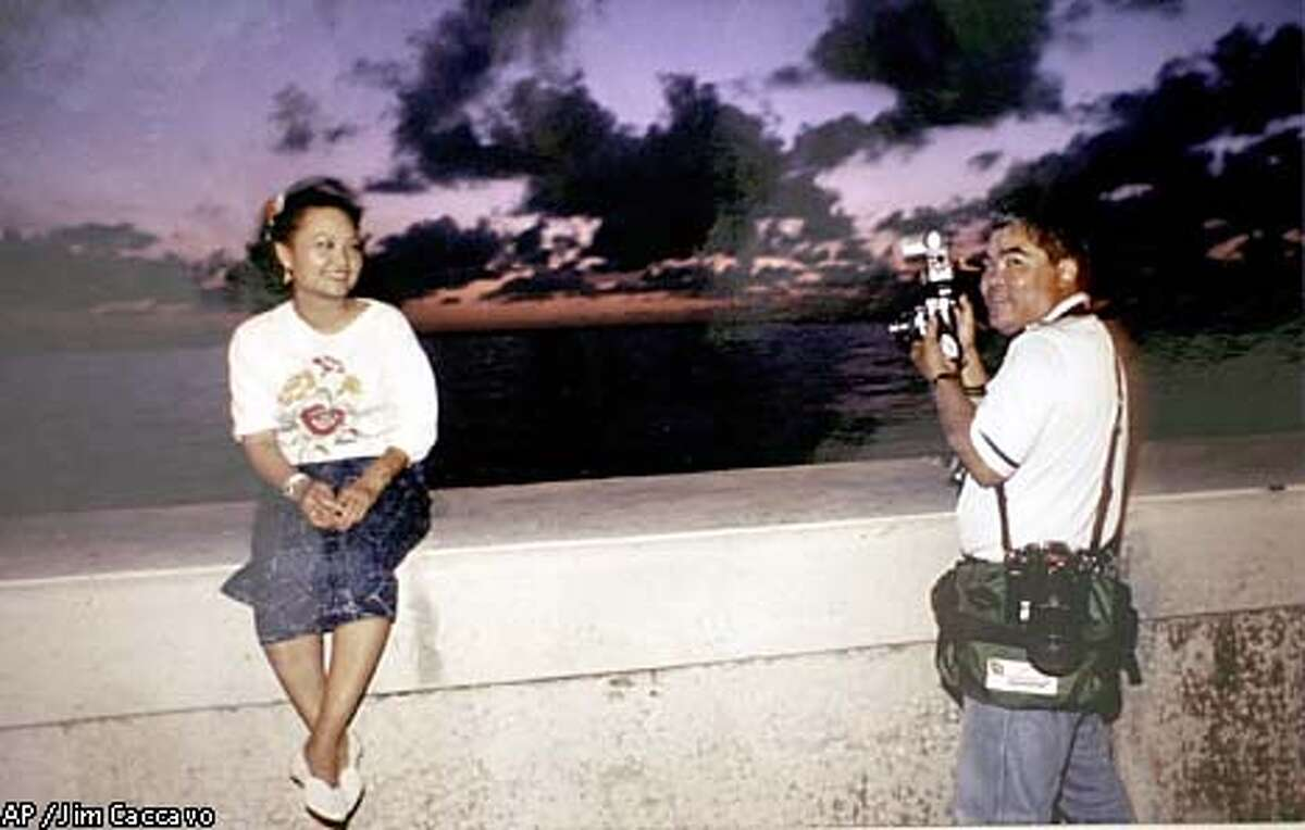 Kim Phuc sat on a Havana seawall in 1989 and had her picture taken by Associated Press photographer Nick Ut. It was the first time the two had seen each other since the end of the Vietnam War in 1975. Associated Press photo by Jim Caccavo