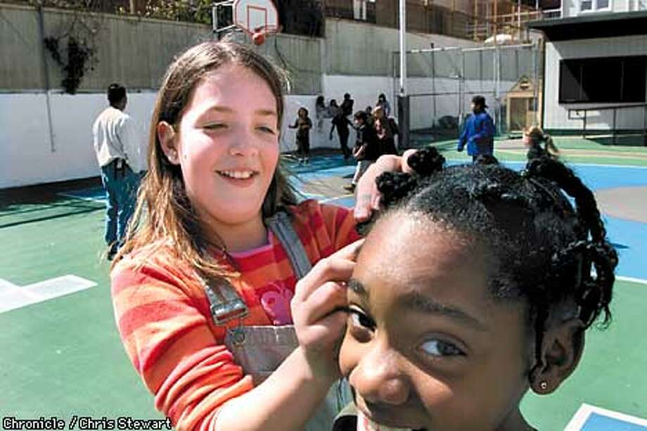Emma Cott (L), 9, does the hair of fellow third grader Janina Watson, 9, during recess at Harvey Milk Elementary School, 4235 19th Street, SF. The new census figures show big jumps in ethnic diversity reflected in our schools as well as our homes. SAN FRANCISCO CHRONICLE PHOTO BY CHRIS STEWART Photo: CHRIS STEWART