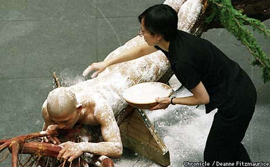 Artist Zhang Huan had his naked body painted with hotdog puree before having a pack of dogs lick it off at the Asian Art Museum of S.F. CHRONICLE PHOTO BY DEANNE FITZMAURICE Photo: DEANNE FITZMAURICE