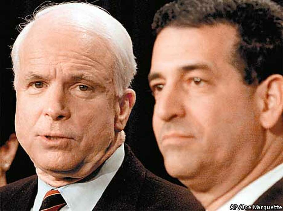Sen. John McCain, R-Ariz, left, and Sen. Russ Feingold, D-Wis, right hold a news conference Monday, April 2, 2001 at the Capitol in Washington. The Senate approved landmark legislation Monday to reduce the influence of big money in political campaigns. The McCain Feingold bill passed in the Senate 59-41. (AP Photo/Joe Marquette) Photo: JOE MARQUETTE