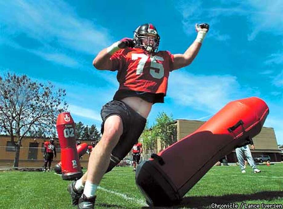 Defensive lineman #75 Carl Hansen attacks the bags on the Diablo Valley College practice field wed. No matter what the San Francisco Demons do they seem to cause a controversy. This time it's over a $50,000 donation to Diablo Valley College. By LANCE IVERSEN/SAN FRANCISCO CHRONICLE Photo: LANCE IVERSEN