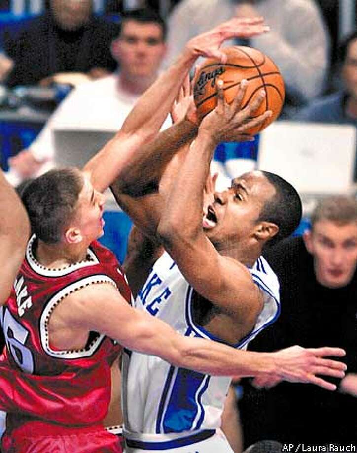 Maryland's Steve Blake goes up to block a shot by Duke's Jason Williams in the second half of their sedmifinal game oof the in Minneapolis on Saturday, March 31, 2001. (AP Photo/Laura Rauch) Photo: LAURA RAUCH