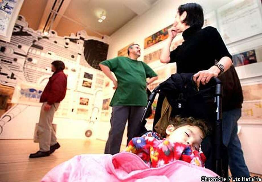 Enda Heneghan, 2, takes a snooze break while touring the San Francisco Museum of Modern Art with her parents, Tom and Shoko Heneghan Chronicle Photo by Liz Hafalia