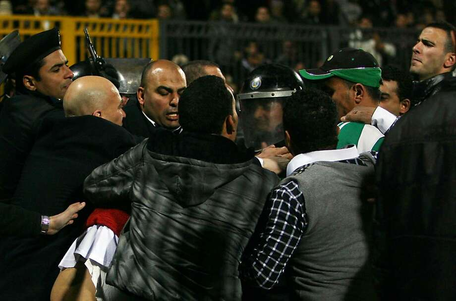 Egyptian police clash with fans after a football match between Al-Ahly and Al-Masry teams in Port Said, 220 kms northeast of Cairo, on February 1, 2012. At least 73 people were killed and hundreds injured according to medical sources. Photo: -, AFP/Getty Images
