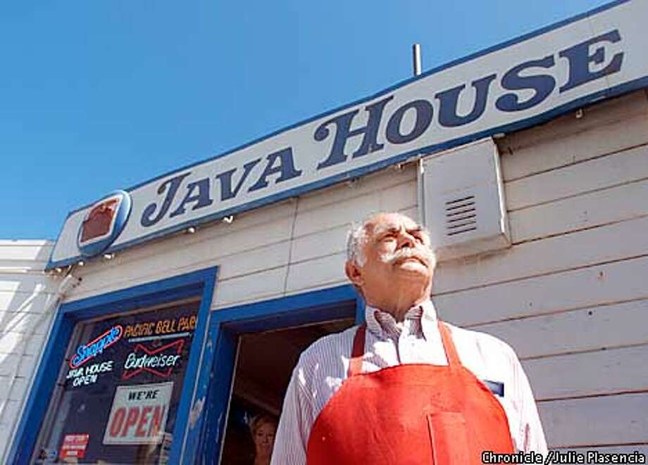 Java House owner, Philip Papadopoulos, glances over to Giant's Pacific Bell Park on a pre-game Saturday in South Beach. (JULIE PLASENCIA/THE CHRONICLE) Photo: JULIE PLASENCIA