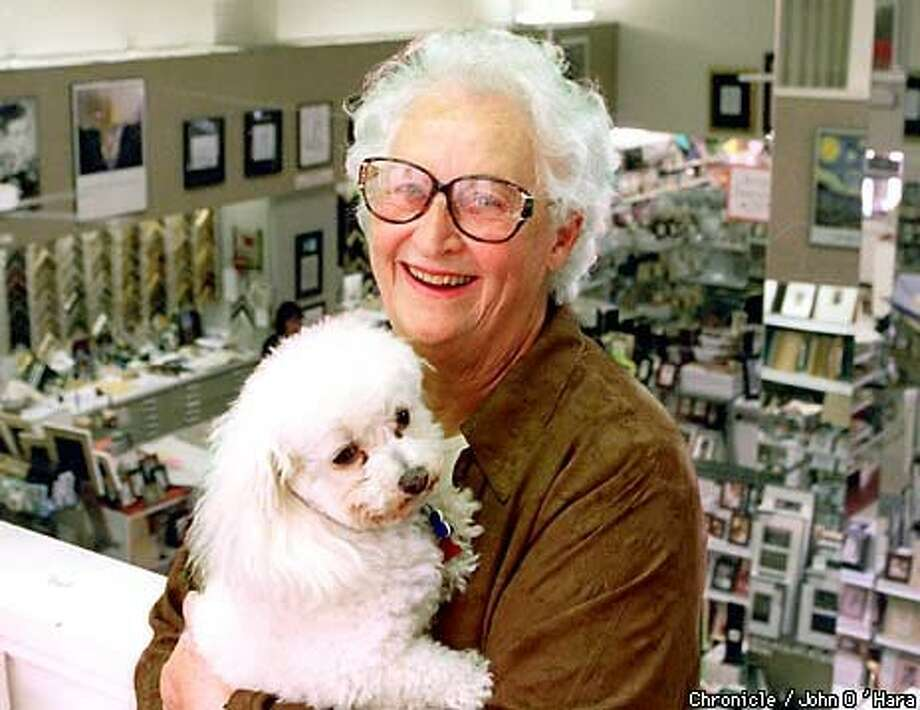 Virginia Biondi brought her dog Pepi into work at the store she founded 51 years ago. Chronicle Photo by John O'Hara