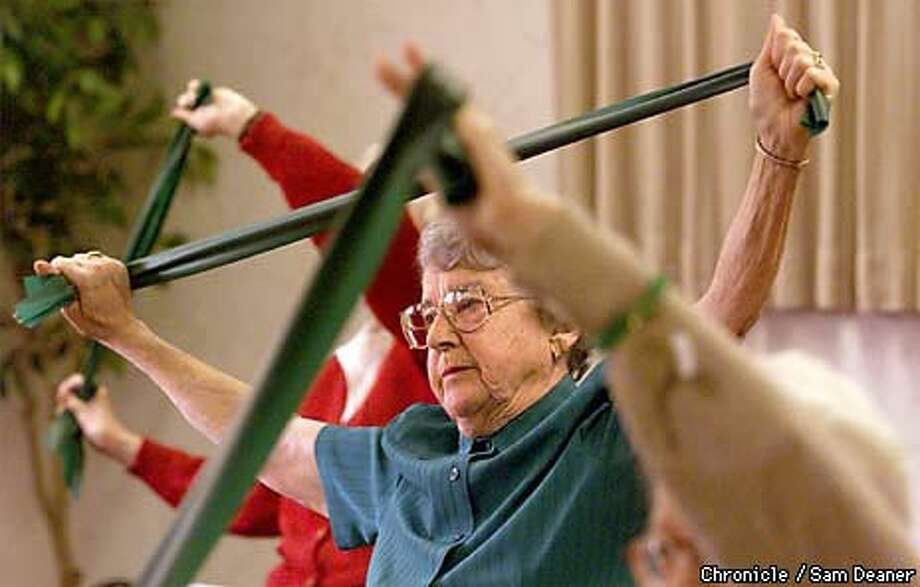 Anita Abernathy, 87, stretches, working to strengthen muscles during senior fitness class at Kensington Place Retirement Community in Walnut Creek. Chronicle Photo by Sam Deaner