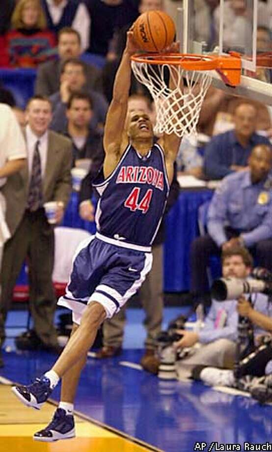 In a familiar sight, Arizona's Richard Jefferson turned a second-half steal into a dunk. Associated Press photo by Laura Rauch