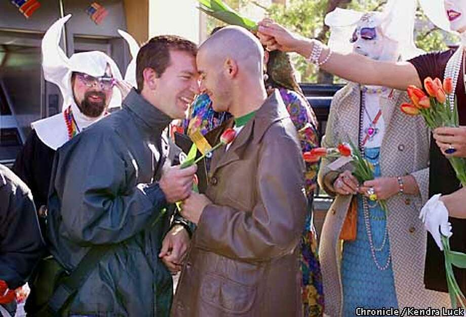 Barak Bengal of San Francisco and Saar Pelles of Israel share a moment after the tulip (two lips) come together with the Sister of Perpetual Indulgence out in support. The event was at Harvey Milk Plaza in honor of the Netherlands and their recognition of same sex marriages by the government.  (KENDRA LUCK/SAN FRANCISCO CHRONICLE) Photo: KENDRA LUCK