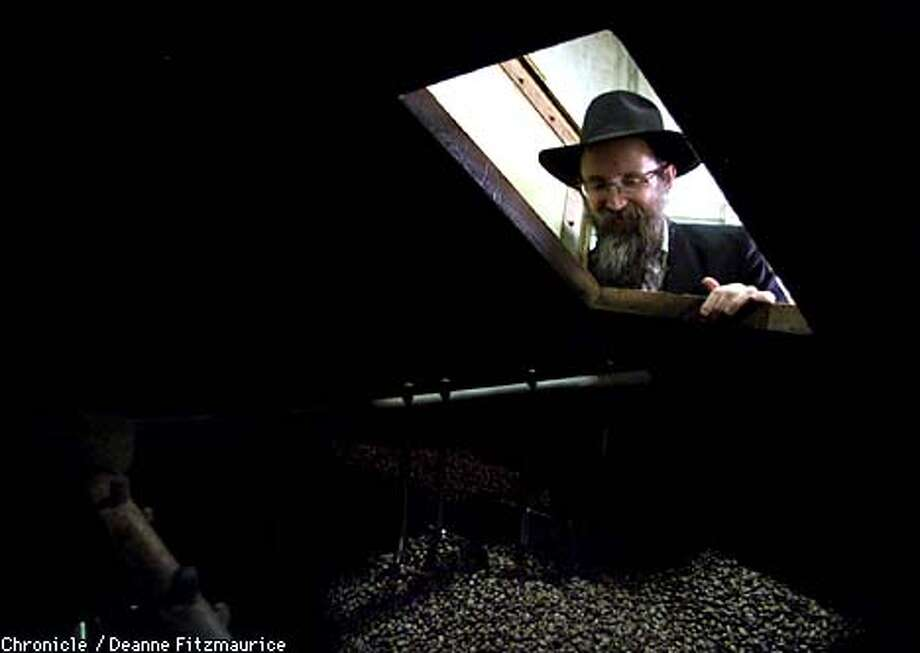 Rabbi Ben-Tzion Welton peered into a coffee roaster at Jeremiah's Pick Coffee to make sure everything was kosher. Chronicle photo by Deanne Fitzmaurice
