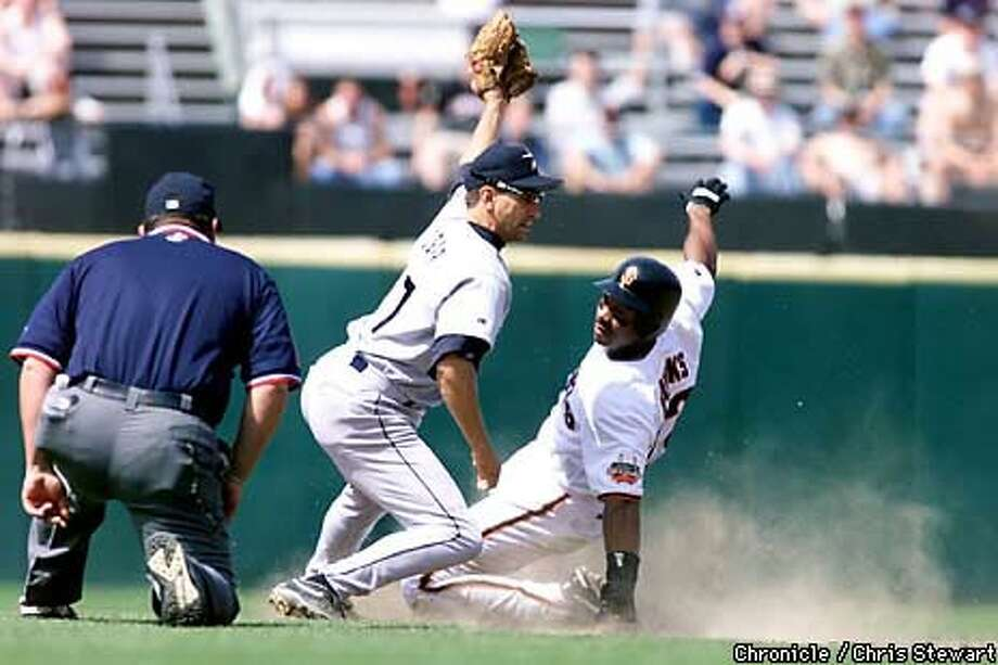 The Giants' Ellis Burks (right) slid under the tag of Houston's Tim Bogar to steal second base in the sixth inning yesterday. Burks later scored on a single by Charlie Hayes. Chronicle Photo by Chris Stewart