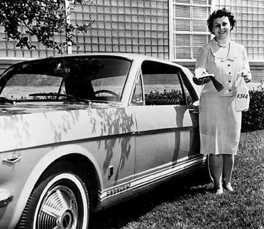 "Evelyn Ryan showed off her prizes after winning Dr Pepper's ""Time of Your Life"" contest in 1965: a new Mustang, two gold watches, plane tickets to Switzerland and a bag of money marked $3,440.64. Photo from ""The Prize Winner of Defiance, Ohio"""