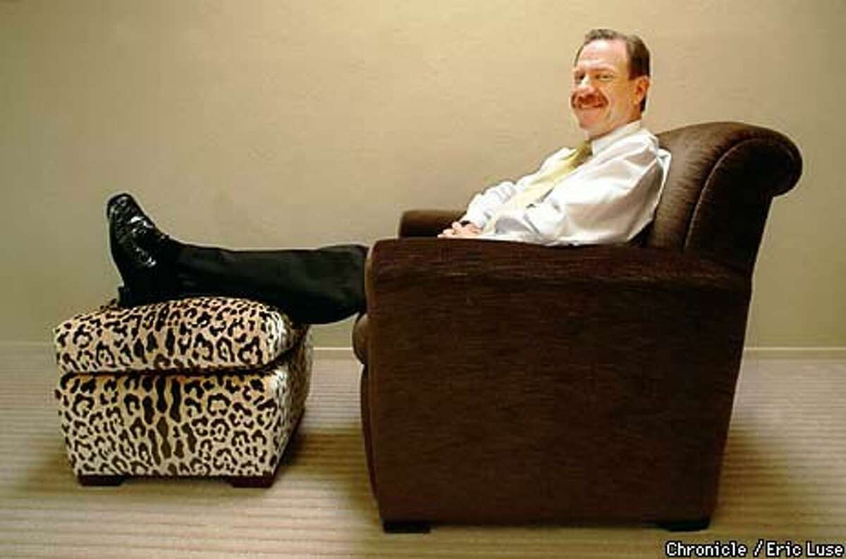 AT EASE: Gary Hutton tries out his newest chair design, ``The York.'' Chronicle Photo by Eric Luse