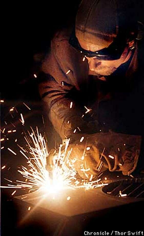 EBCRUCIBLEE/C/12JUNE99/EF/TS --DON CARLSON welds at the opening night party of Crucible.  BY THOR SWIFT/THE CHRONICLE Photo: THOR SWIFT