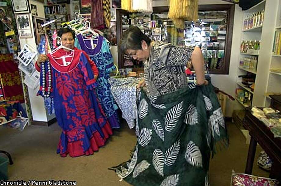 At the Hawaii Store in San Francisco, Ledy Aquino (left) looked through a display of traditional Hawaiian muumuus while Belen Sotto studied a lavalava, a rectangular piece of cloth worn like a kilt. Chronicle photo by Penni Gladstone