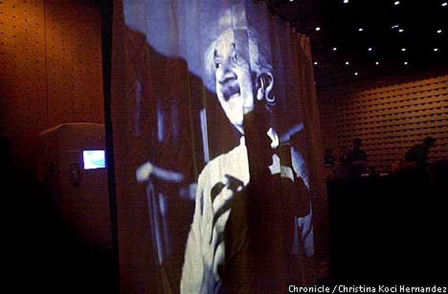 "WBBLASTHAUSf-C-MAR10-SF-CH  CHRISTINA KOCI HERNANDEZ/CHRONICLE Blasthaus orchestrates a party at MOMA, for the opening of ""01011"" exhibition. This is a slide projected onto a curtain in the Schwab room near the lobby at MOMA. Will Limm is the Director of Blasthaus, a high tech arts production group that puts on techy parties with laser beams, etc.. Photo: CHRISTINA KOCI HERNANDEZ"