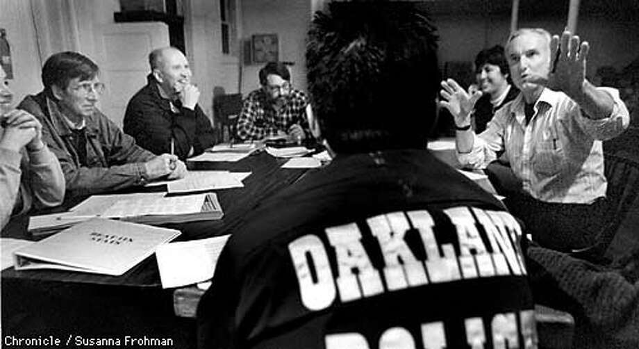Don Link talked to Officer Jimmy Wong at the residents' monthly meeting at the United Methodist Church on Shattuck Avenue in Oakland. Chronicle Photo by Susanna Frohman
