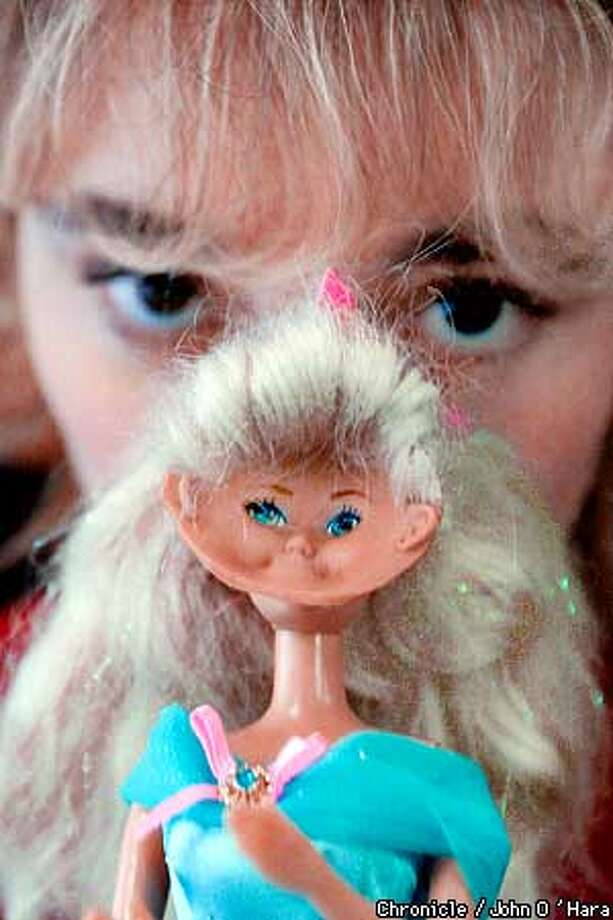 "Rohnert Park, CA. Sonoma State Univ. 1801 E. Cotati Ave.  A Barbie' remodel 'workshop.  Kick off for Womanen's History month , the annual Barbie remodel workshop.  ""Tara Shokitano 'cq.. 21 of Petaluma, with her inside out face barbie .  Sebastapol Artist, Deborah Colotti conduts the class  Photo/John O'Hara Photo: JOHN O'HARA"