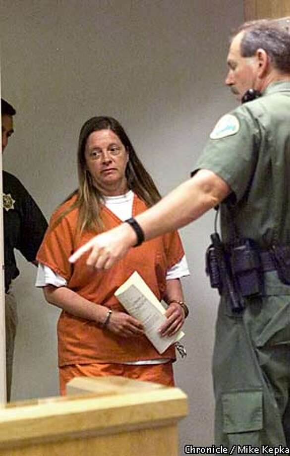 Marjorie Knoller was escorted to a hearing in the Tehama County courthouse. Chronicle photo by Mike Kepka