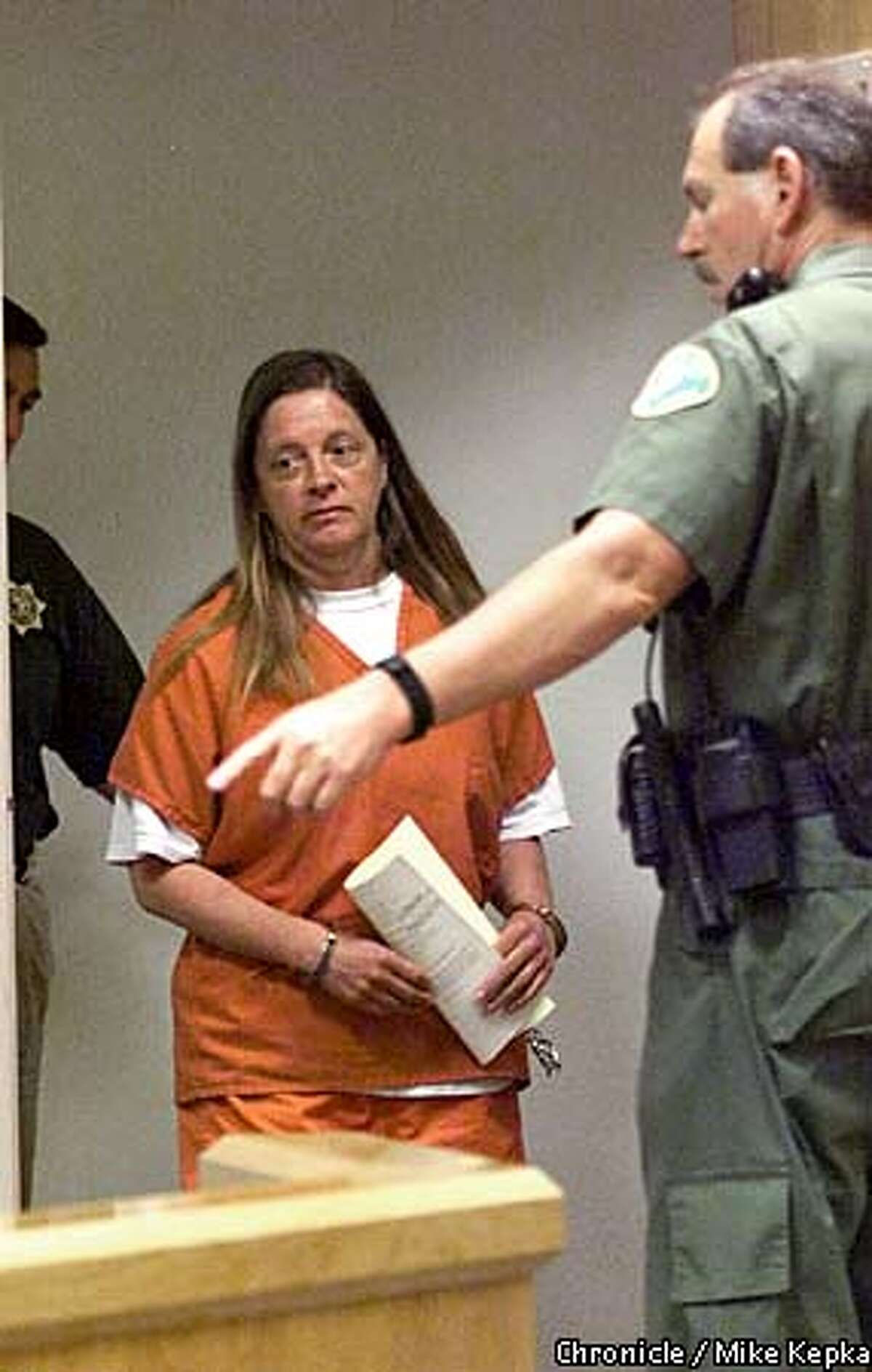 Marjorie Knoller was escorted to a hearing in the Tehama County courthouse.