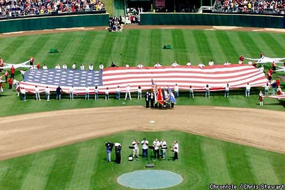 The Giants' home opener vs the San Diego Padres featured a huge American flag during the presentation of the colors prior to the ceremonial first pitch. Chronicle Photo by Chris Stewart