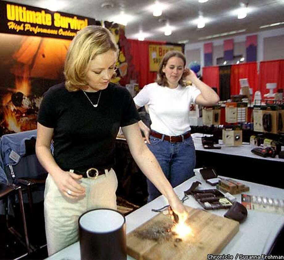 Maggie McDonald, a representative of Survival Incorporated, demonstrates how the Blast Match (from the company's line of Ultimate Survival High Performance Outdoors Tools) works during the Year 2000 Expo in San Jose. Chronicle Photo by Susanna Frohman
