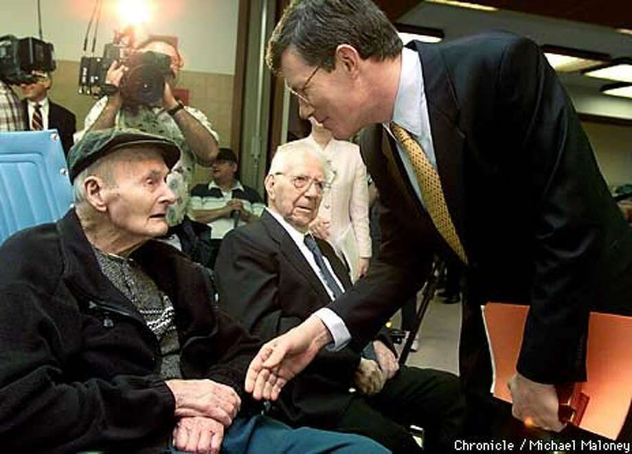 French Consul General Andre Parant honored Oscar Lewis, 106, (left) and Oscar Becker, 102, at a ceremony for the World War I veterans Chronicle Photo by Michael Maloney
