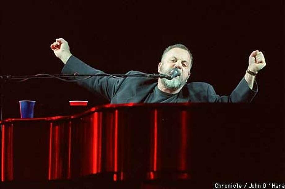 Piano man -- Billy Joel at the San Jose Arena. Chronicle Photo by John O'Hara