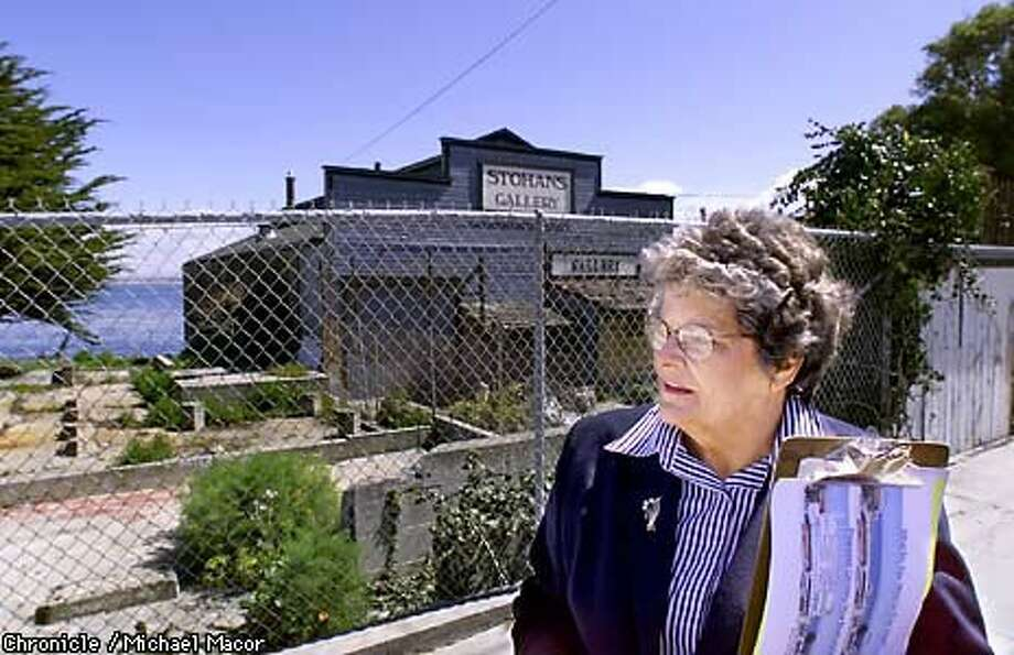 Barbara Evans stood in front of the last big plot of undeveloped land on Cannery Row; she favors tighter restrictions on development. Chronicle Photo by Michael Macor