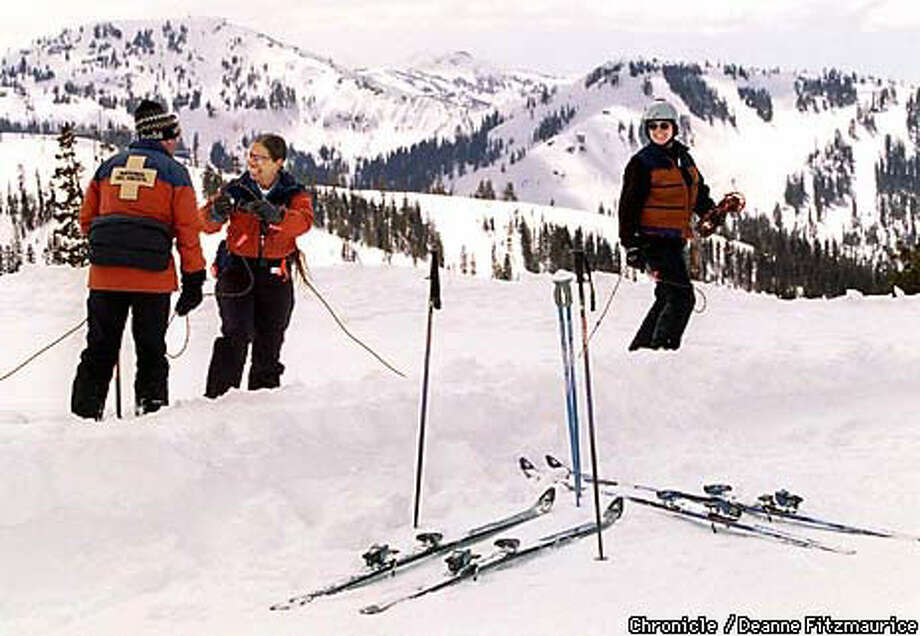 National Ski Patrol members (left to right) Walt Singletary, Jan Bee and Terry Neimeyer set up a rope boundary at Boreal ski area on Donner Summit in the Sierra. Chronicle Photo by Deanne Fitzmaurice