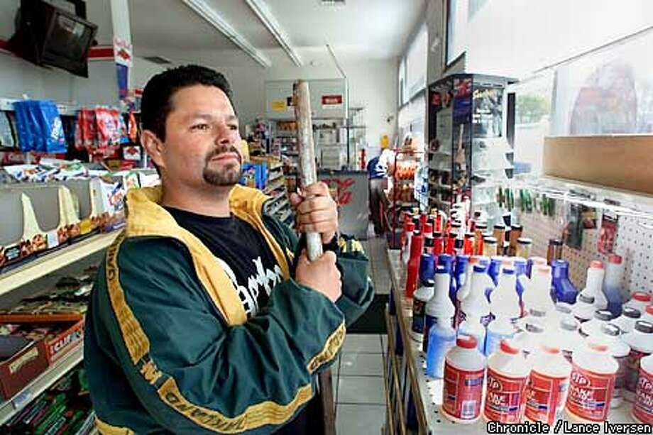 Jose Vega who operates University Arco at 6th and University Ave keeps an eye on PG&E crews working to stop a gas leak across the street. For more than two hours traffic was disrupted and some business were asked to close including University Arco . By LANCE IVERSEN/SAN FRANCISCO CHRONICLE Photo: LANCE IVERSEN