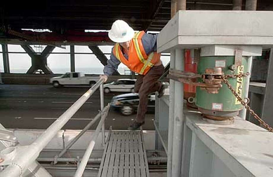 BAYBRIDGEa-C-27MAR01-MN-LA  Bryan Chew, a Resident Engineer with Cal-Trans jumps off the colum after checking on one of the four jacks on the northside of the Bay Bridge. The bridge will be lifted 1/2 inch on Thursday for a part of the earthquake retrofit.  Photo By Lacy Atkins/San Francisco Chronicle Photo: Lacy Atkins