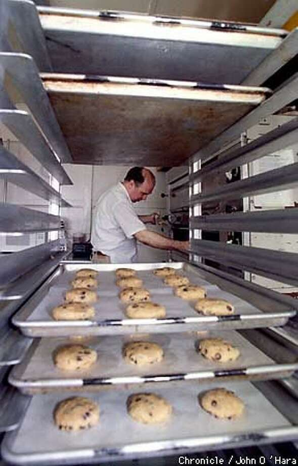 CHIPPING AWAY: Joe Schuver of Destination Baking prepares cookies for other caterers at Eclectic Catering. Chronicle Photo by John O'Hara