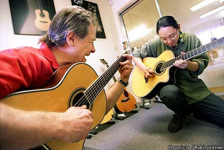 President Charles Fox (left) and Jonathan Lee, vice president and CEO, jammed at the Charles Fox Guitars offices in Healdsburg. Chronicle Photo by Robin Weiner