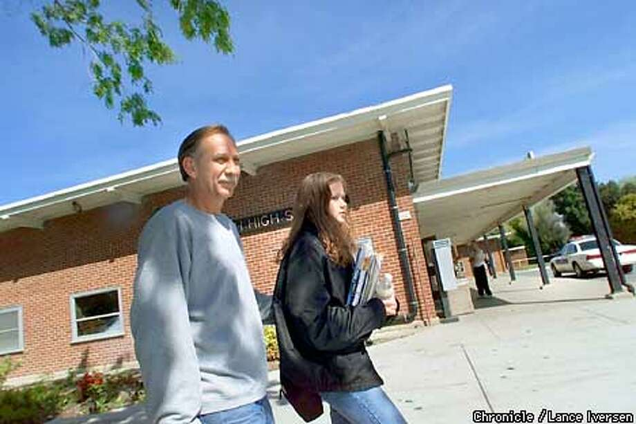 Stephen Estes picks up his daughter Jennifer age 15 from Antioch High School monday morning after hundreds of kids called their parents to inform them of a rumor, about a gunman was going to attack the campus. Even with increased presence by Antioch Police and faculty hundreds of parents came by to pick up their kids. By LANCE IVERSEN/SAN FRANCISCO CHRONICLE Photo: LANCE IVERSEN