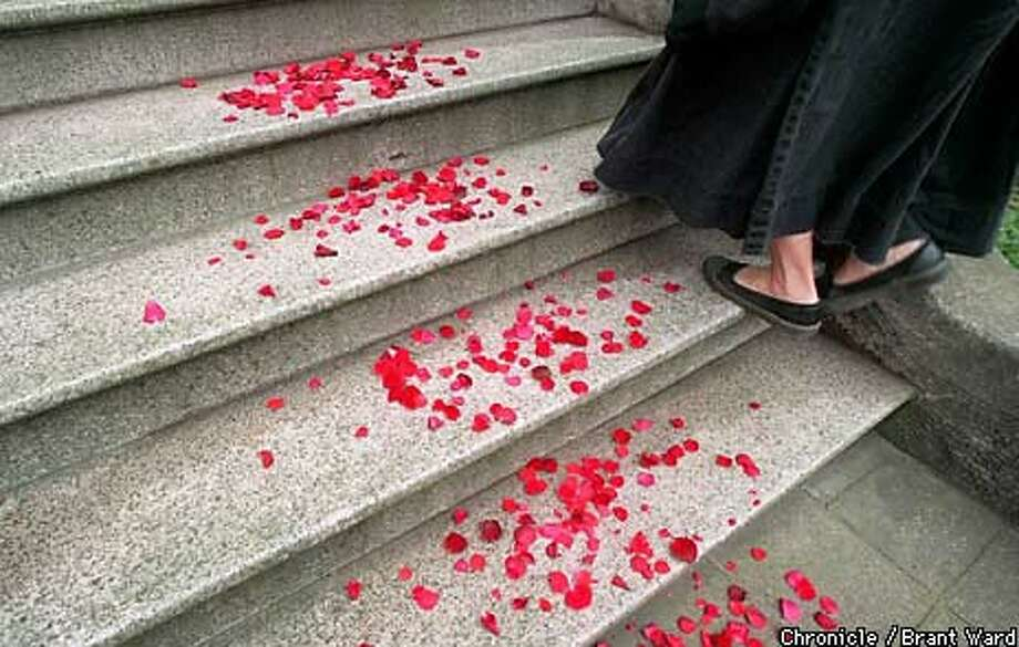 Flower petals were strewn on the steps of the Zen Center in San Francisco to celebrate the installation of the new abbot. Chronicle Photo by Brant Ward
