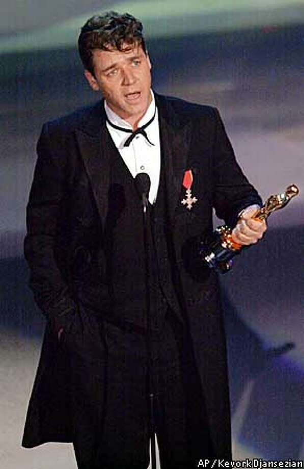 """EMBARGOED AT THE REQUEST OF THE MOTION PICTURE ACADEMY FOR USE UPON CONCLUSION OF ACADEMY AWARDS TELECAST--Russell Crowe speaks after winning the best actor Oscar for the film """"Gladiator,"""" during the 73rd annual Academy Awards Sunday March 25, 2001 in Los Angeles. (AP Photo/Kevork Djansezian) Photo: KEVORK DJANSEZIAN"""