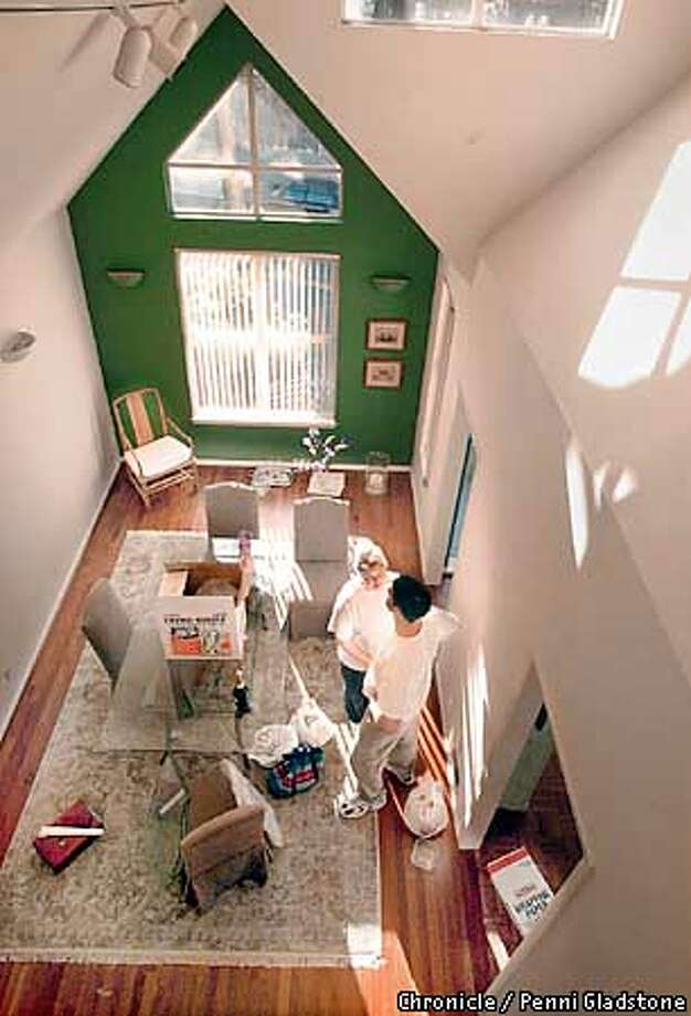 Michael Joffe and Jennifer Shepherd share a quiet moment in the dining room area of their condo. Dot-com casualties moving out of Bay Area. After years of renting separate apartments in San Francisco, Michael Joffe and Jennifer Shepherd last year bought a two-bedroom townhome. It made sense. Instead of watching their money go out the door in monthly rents, they would invest in mortgage payments. Both have been laid off from their jobs, have sold their home - breaking even - and are moving to Seattle. A sign the Bay Area's rental market and real estate may not be so hot anymore. PHOTO BY PENNI GLADSTONE Photo: Penni Gladstone
