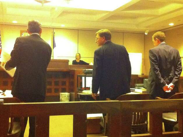 During the testimony of Elizabeth Peacock, a Bexar County Medical Examiner's Office doctor, defense attorney Roy Barrera Jr. (left) argues with prosecutors Charles Rich (middle) and Clayton Haden (right) about whether Peacock could authoritatively comment on whether the victim could have survived if given immediate medical attention. Photo: Jessica Kwong, Jkwong@express-news.net
