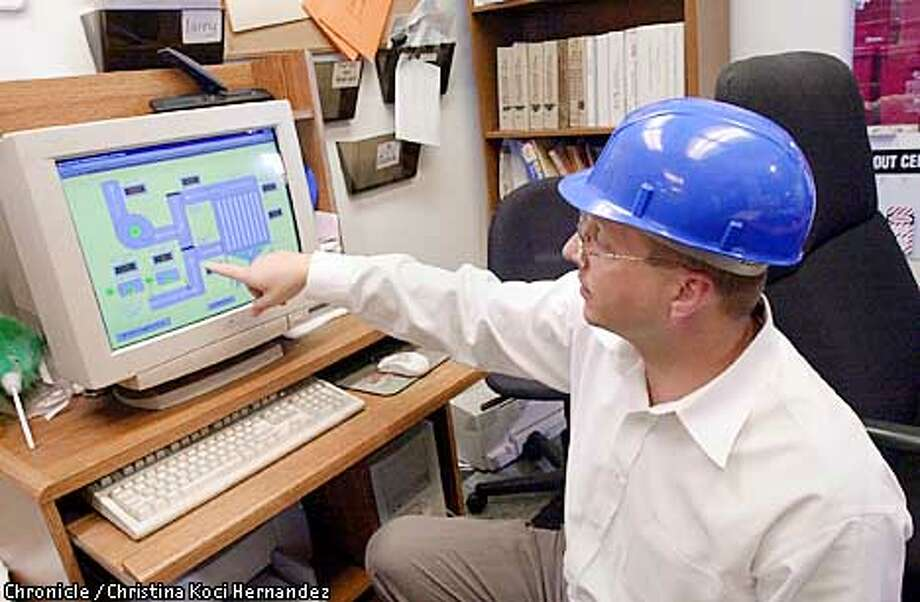 IESXXg-C-MAR2201-EZ-CH  CHRISTINA KOCI HERNANDEZ/CHRONICLE  Integrated Environmental Systems, on High St. in Oakland, is the only major commercial medical waste incinerator in the state. Here, general manager, Richard Dubiel, explains the use of a systems computer in the control room. Integrated Environmental Systems is located in East Oakland, and environmental groups are working with local community leaders to shut it down, saying it is an example of environmental racism. The by-products of this incineration include dioxin and mercury. Critics say the business surpasses legal emission levels. Photo: CHRISTINA KOCI HERNANDEZ