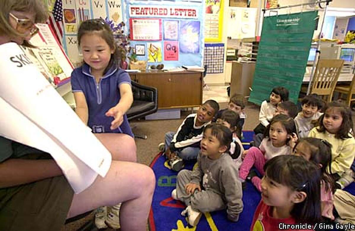 Samantha Chang read to her Fremont kindergarten classmates from a book she wrote. Chronicle photo by Gina Gayle