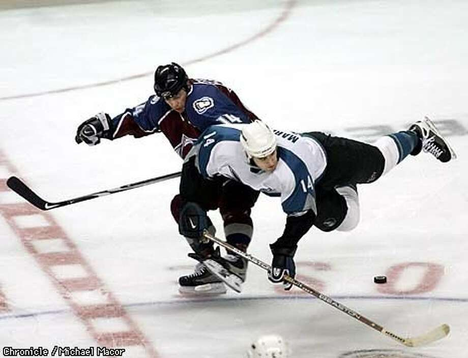 Colorado's Theo Fleury (left) and the Sharks' Patrick Marleau tangled, sending Marleau flying, during the first period of San Jose's 3-2 loss to the Avalanche. Chronicle Photo by Michael Macor