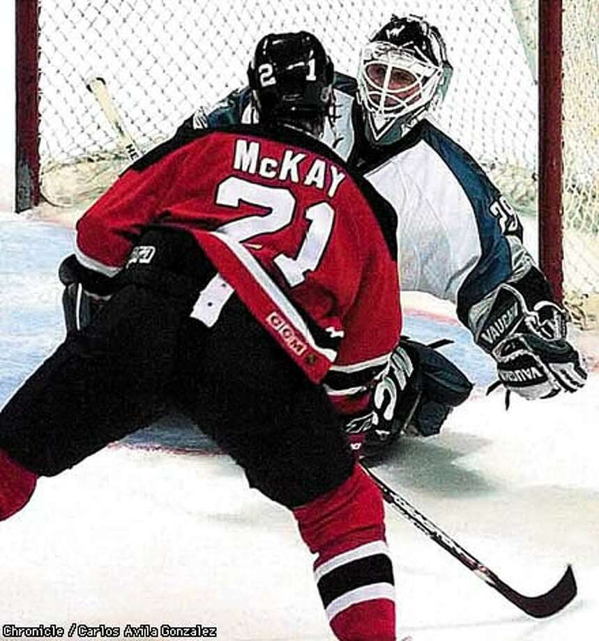 Andy Sutton of the Sharks, tries to get around Randy McKay of the New  Jersey Devils during the Sharks' 3-1 victory over the Devils on Monday. Chronicle Photo by Carlos Avila Gonzalez