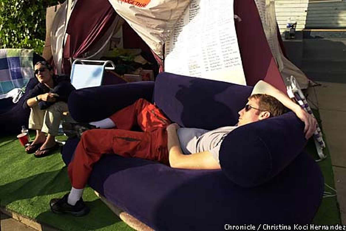 Rob McArthur of San Diego relaxed on a blow-up couch in anticipation of stars making their way down the red carpet at the Oscars. Chronicle photo by Christina Koci Hernandez