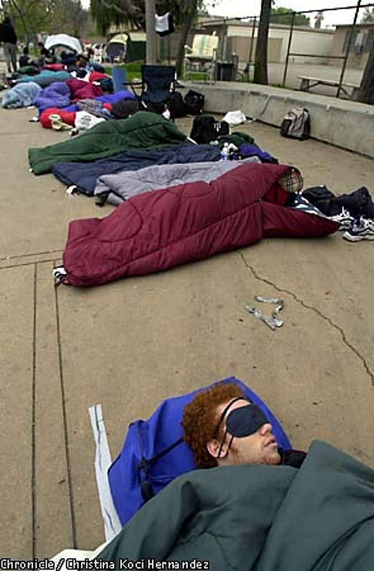 Jeremy Benjamin of Los Angeles, foreground, got some sleep along with other fans on University Avenue in Los Angeles early yesterday morning. Chronicle photo by Christina Koci Hernandez