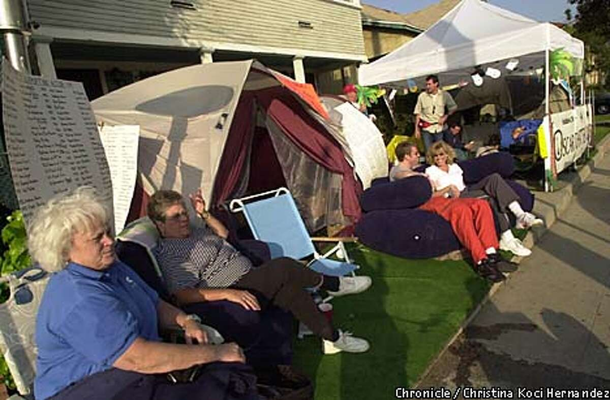 Marge De Novi of Anaheim, far left, and Babe Churchill of Chino waited in line near their tents to get bleacher seats at the awards show.
