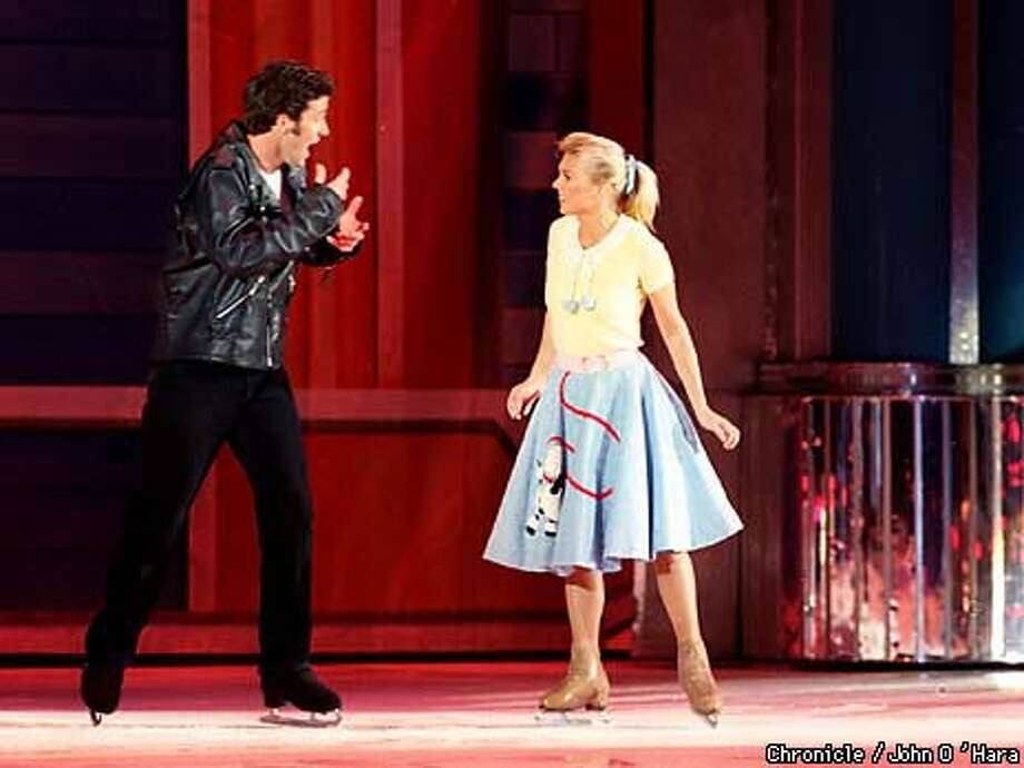 Matthew Williams is Danny and Jennifer Schmitz is Sandy in ``Grease on Ice.'' Chronicle Photo by John O'Hara