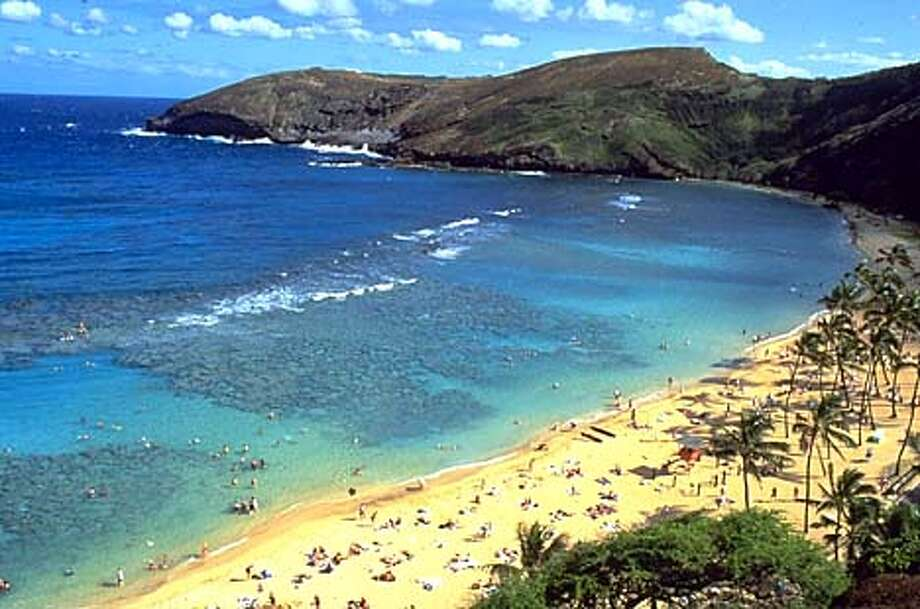 Hanauma Bay, one of Oahu's most popular natural attractions, is an easy ride from downtown Waikiki on TheBus. Photo courtesy of Oahu Visitors Bureau